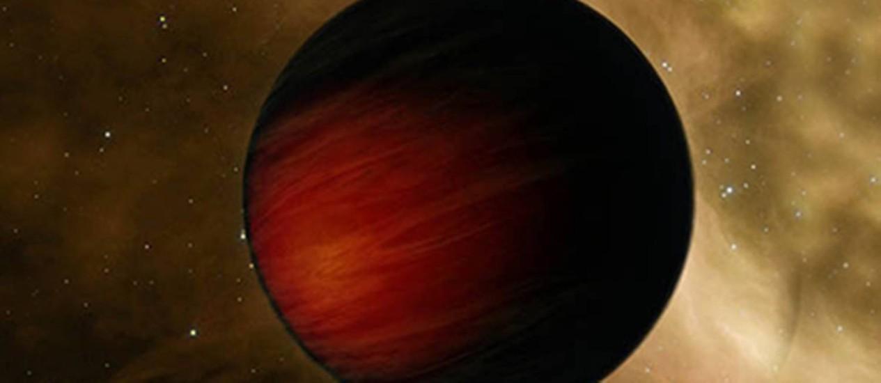 Ilustração do planeta extrassolar TrES2-b, apelidado 'Cavaleiro Negro': com duas vezes o tamanho de Júpiter, ele é o exoplaneta mais escuro conhecido até o momento, refletindo apenas cerca de 1% da luz recebida de sua estrela-mãe Foto: Nasa/JPL-Caltech/T. Pyle