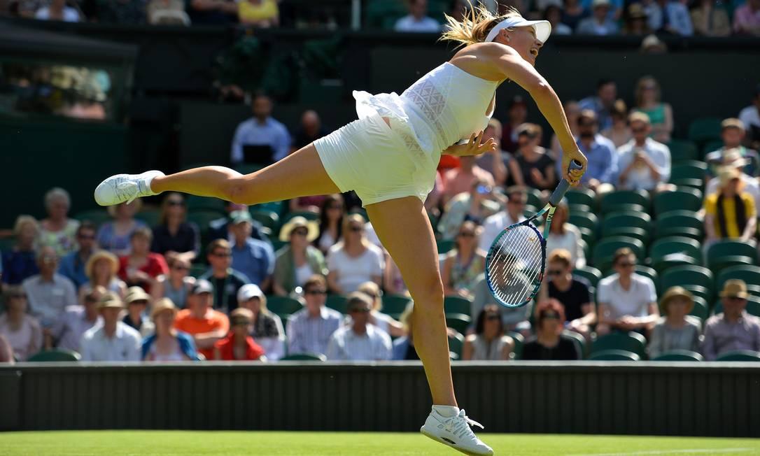 O saque foi uma das armas da tenista da Rússia GLYN KIRK / AFP
