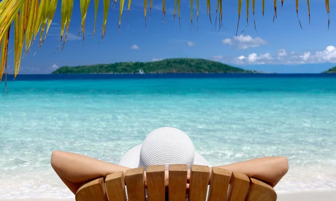 Turista de férias na praia Foto: Divulgação