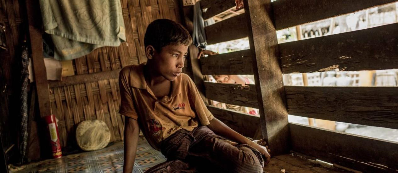 Jubair, de 13 anos, que foi abandonado pela mãe durante fuga da família para a Malásia Foto: NYT/2-7-2015