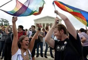 Ativistas comemoram a decisão da Suprema Corte Foto: AFP