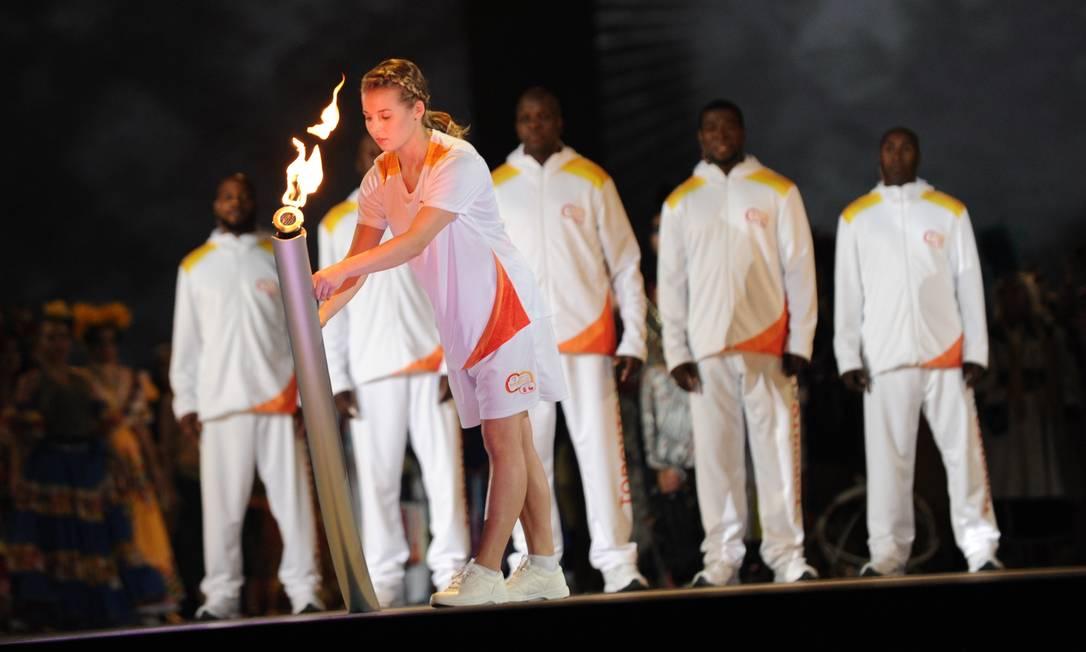 A chegada da tocha pan-americana à cerimônia HECTOR RETAMAL / AFP