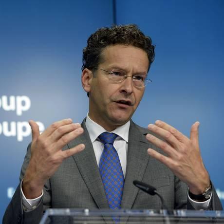 Jeroen Dijsselbloem, presidente do Eurogrupo, afirmou que ajuda financeira poderá levar até quatro semanas Foto: Thierry Charlier / AFP