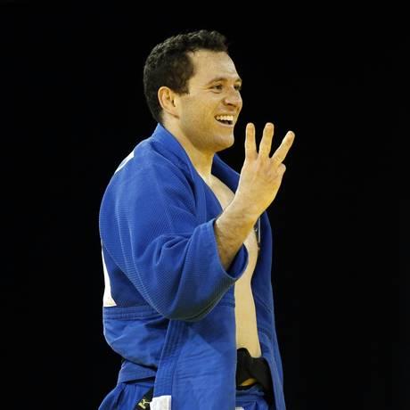Tiago Camilo comemora o tricampeonato pan-americano Foto: Julio Cortez / AP