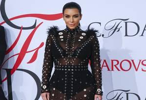 Grávida de seu segundo filho (é um menino), Kim Kardashian segue firme com o seu objetivo de virar um ícone da moda (para muitos, ela já é). Ela abusa de looks de estilistas badalados, como este Proenza Schouler que ela usou no último CFDA Fashion Awards Foto: LUCAS JACKSON / REUTERS