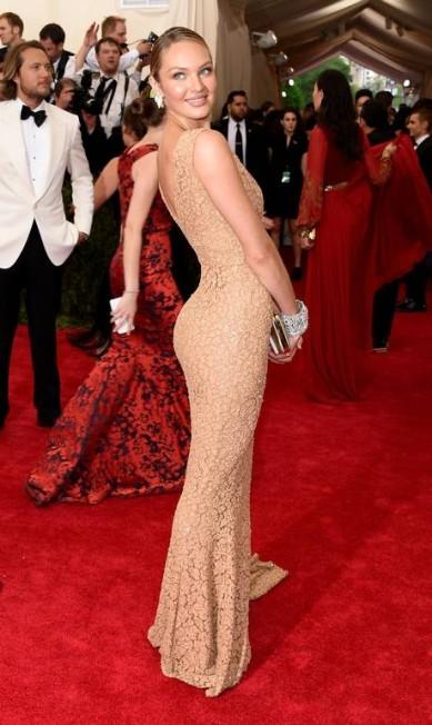 O bumbum positivo de Candice Swanepoel, a top da barriga negativa Larry Busacca / AFP