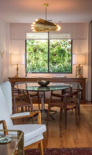 Sala De Jantar Florenca Lopas ~ Para a sala de jantar, a mesa redonda de Florence Knoll resolve a