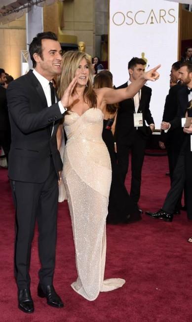O que será que Justin Theroux e Jennifer Aniston viram? Chris Pizzello / Chris Pizzello/Invision/AP
