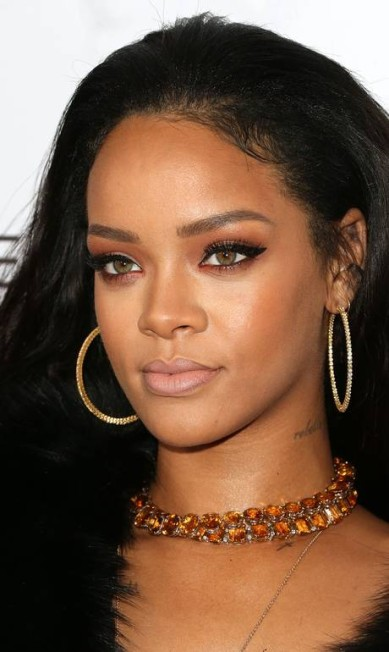 Rihanna em foto recente, de 22 de janeiro. A cantora acaba de vencer uma batalha judicial contra a marca Topshop que estampou sem autorização o rosto da cantora numa t-shirt Frederick M. Brown / AFP