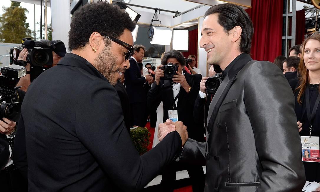Lenny Kravitz e Adrien Brody: encontro de amigos KEVORK DJANSEZIAN / AFP