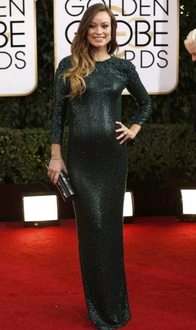 Olivia Wilde, gravidíssima, brilhou literalmente com look da Gucci no Globo de Ouro MARIO ANZUONI / REUTERS