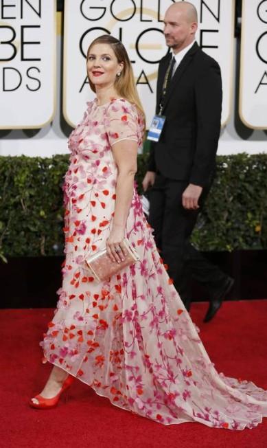 A edição de 2014 do Globo de Ouro também foi repleta de grávidas. A mais notável foi a atriz Drew Barrymore, que usou um look com flores em 3D da estilista Monique Lhuillier DANNY MOLOSHOK / REUTERS