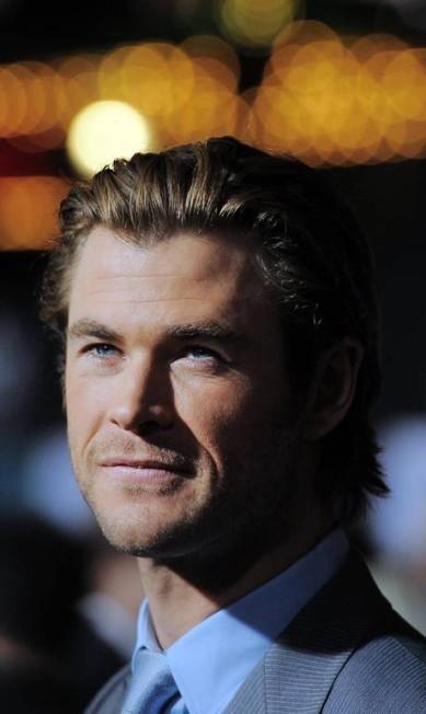 """Conhecido mundialmente como o super-herói Thor, o ator australiano Chris Hemsworth, eleito pela revista """"People"""" como o homem mais sexy de 2014, entregou que não é """"uma pessoa de pijama. É muito quente"""". """"Normalmente, não uso nada"""" JOE KLAMAR / AFP"""