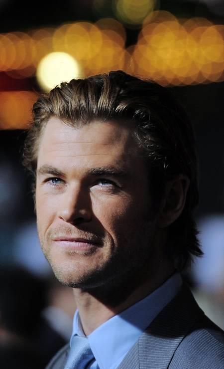 """Aos 31 anos, o ator australiano Chris Hemsworth foi eleito pela revista """"People"""" como o homem mais sexy de 2014. Chris ficou conhecido mundialmente ao interpretar o super-herói Thor no cinema JOE KLAMAR / AFP"""