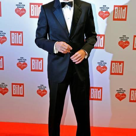 George Clooney. O bigode do ator não fez sucesso Foto: CLEMENS BILAN/AFP