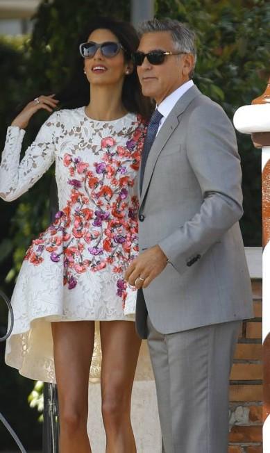 Os dois voltaram ao Hotel Cipriani, onde foi realizada a cerimônia de casamento dos dois no sábado STEFANO RELLANDINI / REUTERS