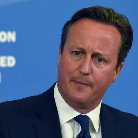 Primeiro-ministro britânico David Cameron faz uma pausa enquanto ele discursa na Ninestiles Academy, em Birmingham, no centro da Inglaterra Foto: PAUL ELLIS / AFP