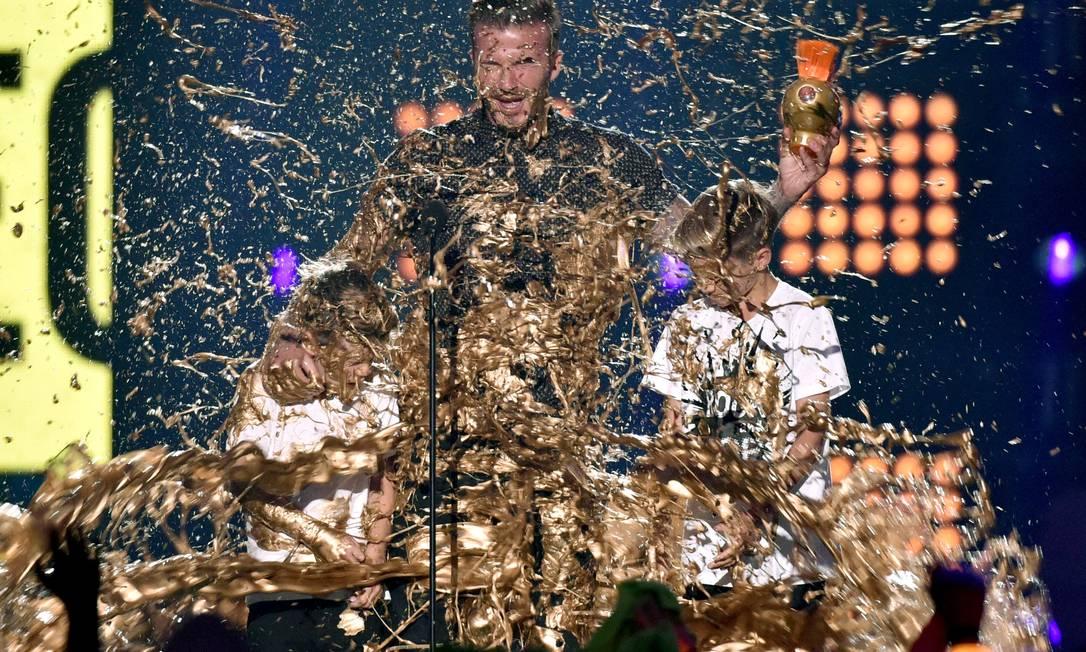 Mas na hora dos agradecimentos... Tinta nos Beckham! John Shearer / John Shearer/Invision/AP