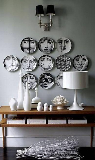 """Pratos da italiana Fornassetti. São mais de 500 rostos femininos criados por Piero Fornassetti: """"Comecei a fazer e não parei mais"""" Divulgação"""