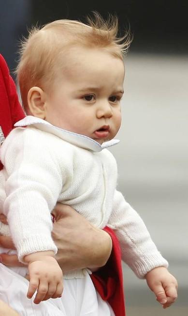 Esta é a primeira viagem do príncipe George, o terceiro na linha de sucessão ao trono britânico PHIL NOBLE / REUTERS