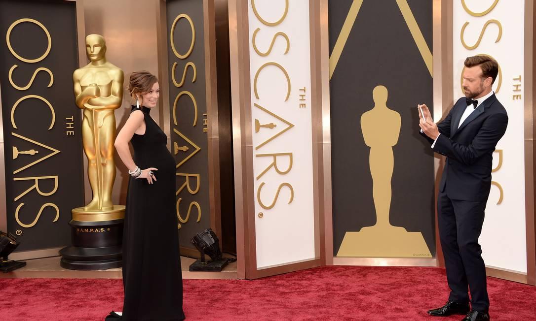 Será que o clique que Jason Sudeikis fez da gravidíssima Olivia Wilde vai parar no Instagram? Jason Merritt / AFP