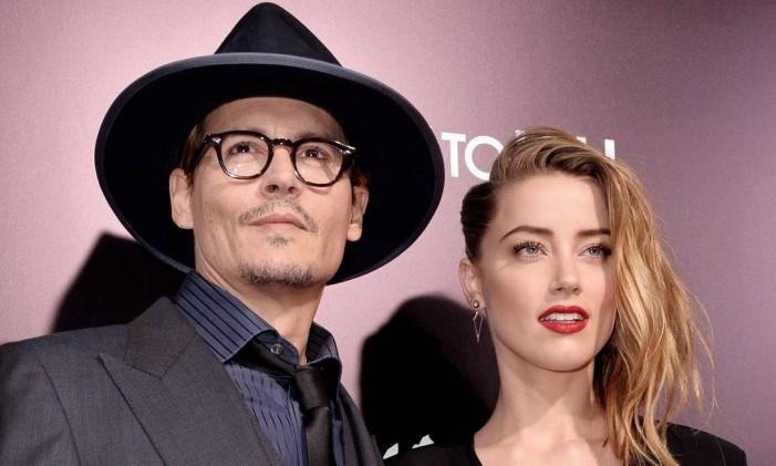 O casal na première de '3 dias para matar', estrelado por Amber Heard ao lado de Kevin Costner Foto: KEVIN WINTER / AFP