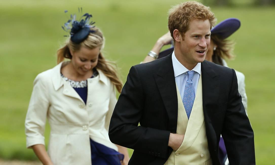 Além de Pippa, os príncipes Harry (na foto) e William também estiveram na festança STEFAN WERMUTH / REUTERS