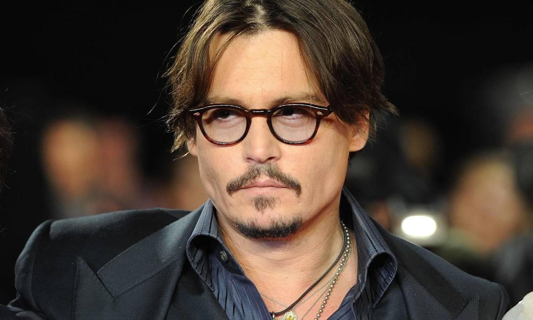"""Johnny Depp não tem medo de piratas, mas não pode nem ver um palhaço. """"Eu tenho esse medo de palhaços. Então, eu acho que se eu me cercar deles, isso vai afastar todo o mal. O que um método de lidar interessante!"""". Será mesmo? PAUL HACKETT / Reuters"""