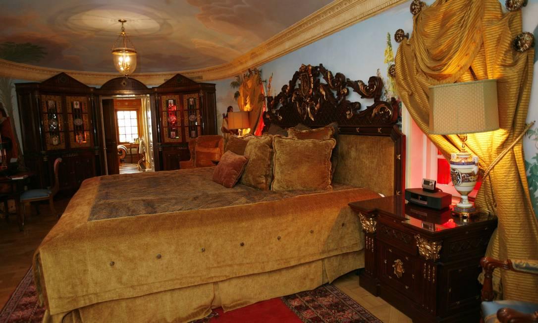 O quarto do estilista: muito dourado e vermelho criam uma atmosfera rococó Lynne Sladky / AP