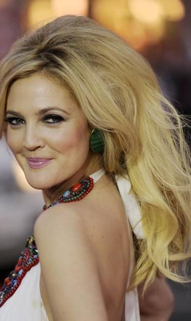 A atriz Drew Barrymore é outra que muda o visual constantemente. Loura, morena ou ruiva... Qual é a sua versão predileta da diva? Chris Pizzello / AP