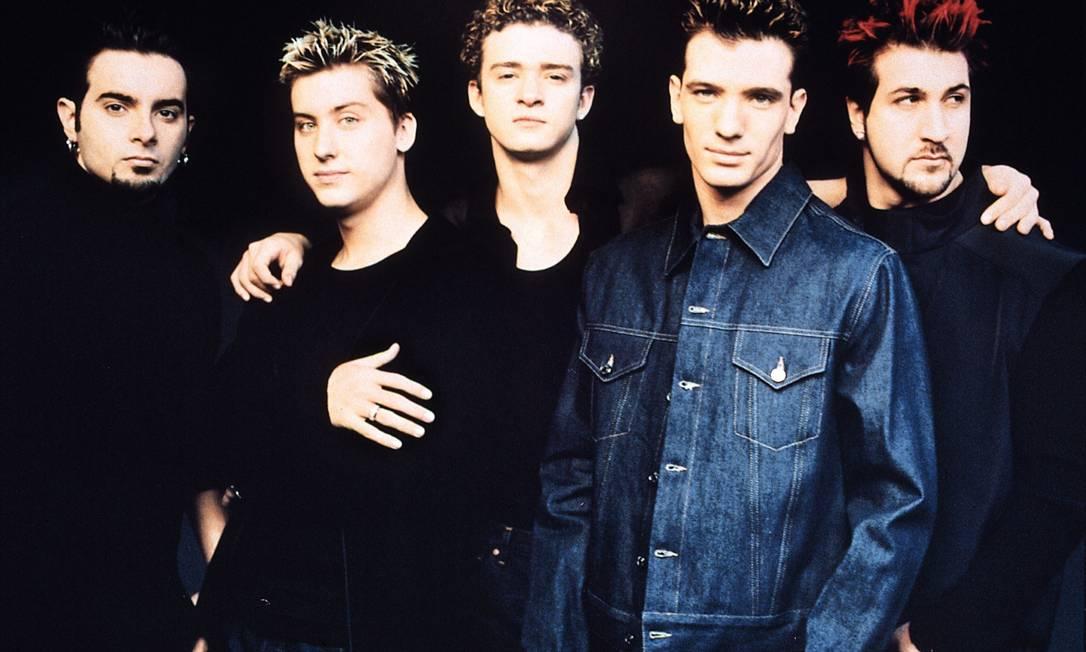 No fim da década de 1990, Justin ficou mundialmente conhecido como um dos líderes da banda 'N Sync. Na época, o cantor apostava em fios mais claros e muitos cachos Divulgação