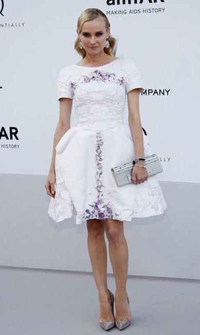 Diane Kruger novamente, chegando para evento beneficente em Antibes, durante o Festival de Cannes Reuters