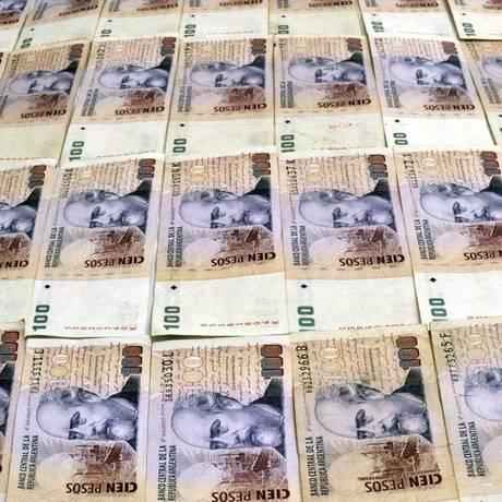 Em baixa. Para economistas, crise prova que câmbio a 9,19 pesos é inviável Foto: Terceiro / Diego Giudice/Bloomberg/3-5-2013
