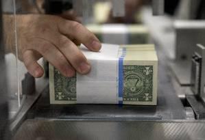 Céduals de dólar, a moeda oficial dos Estados Unidos Foto: Andrew Harrer / Bloomberg News