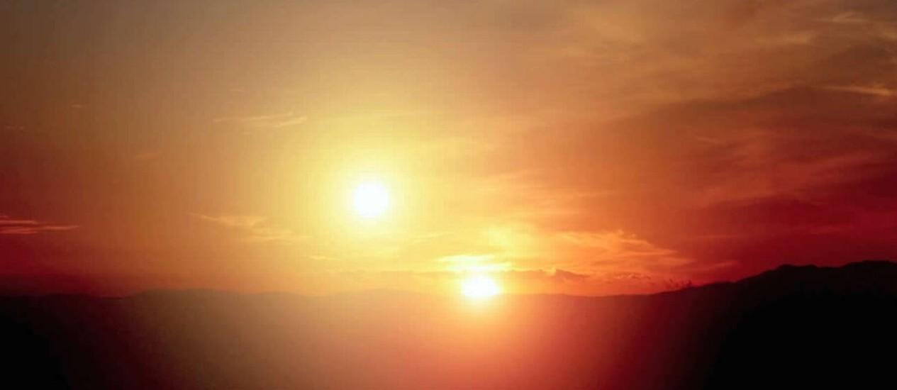 Ilustração de um 'pôr do Sol duplo' como o do fictício Tatooine, da saga 'Guerra nas estrelas', que seria visível da superfície de um exoplaneta circumbinário como o Kepler 453b, não fosse o novo planeta extrassolar provavelmente um inabitável gigante gasoso Foto: NASA/Centro de Pesquisas Ames/Missão Kepler