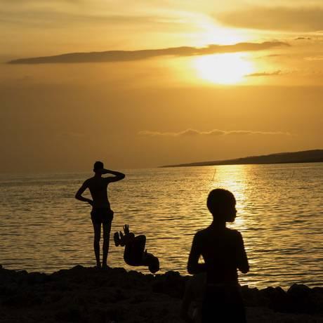 Em La Boca, o cenário caribenho tem tons alaranjados Foto: Ramon Espinosa / AP