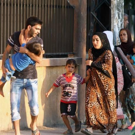 Palestinos refugiados têm fugido do campo por conta de confrontos Foto: Mohammed Zaatari / AP