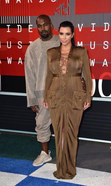 O rapper Kanye West e a socialite Kim Kardashian Jordan Strauss / Jordan Strauss/Invision/AP