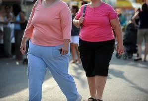 Pessoas que acreditam que obesidade depende apenas do DNA tendem a ser mais relaxadas com a dieta e a prática de exercícios físicos Foto: TIM SLOAN / AFP