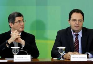 Os Ministro da Fazenda Joaquim Levy e do Planejamento Nelson Barbosa durante entrevista sobre cortes nas contas públicas e aumento de impostos Foto: Ailton de Freitas / Agência O Globo