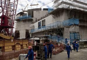 Nova usina. Trabalhadores na construção do reator da usina de Angra 3. As usinas Angra 1 e 2 fornecem menos de 3% da energia do país Foto: Dado Galdieri/Bloomberg/18-11-2013