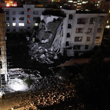 Polícia investiga série de explosões chinesas causas por pacotes-bomba em cidade no sul da China Foto: STR / AFP