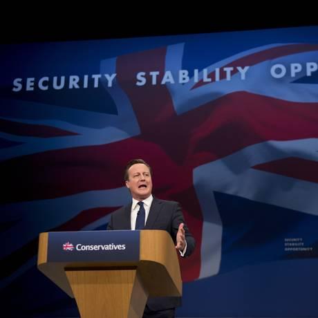 David Cameron, primeiro-ministro britânico, em discurso na convenção do Partido Conservador nesta quarta-feira Foto: Oli Scarff / AFP