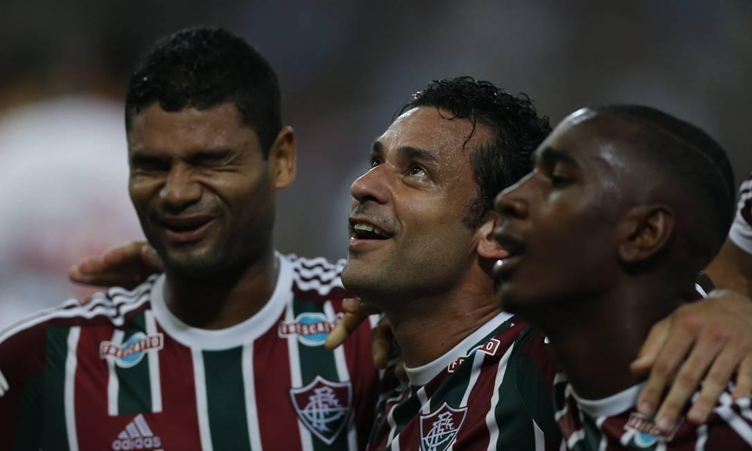 Gum, Fred e Gerson comemoram o gol do Fluminense no primeiro tempo Alexandre Cassiano / Agência O Globo