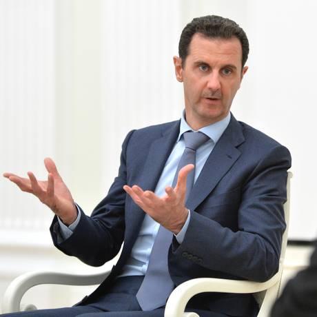 Bashar al-Assad conversa com Putin durante visita a Moscou Foto: Alexei Druzhinin / AP