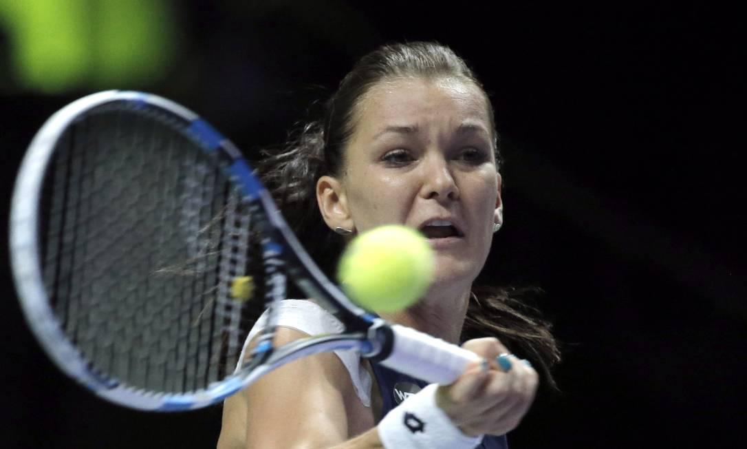 O segundo lugar do grupo de Sharapova ficou com a polonesa Agnieszka Radwanska Jeremy Lee / REUTERS
