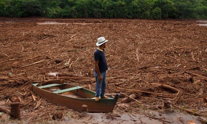 Resultado de imagem para O rompimento de duas barragens da mineradora Samarco