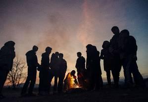 Refugiados em Gevgelija, Macedônia Foto: DIMITAR DILKOFF / AFP