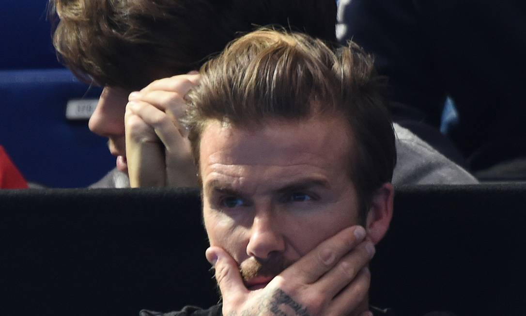Beckham atento ao jogo Tony O'Brien / REUTERS
