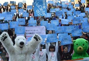 Ativistas pedem ação para conter mudanças climáticas durante passeata em Tóquio Foto: KAZUHIRO NOGI / AFP